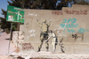 A piece of graffiti by Banksy near the Israeli separation barrier