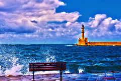 Chania, Crete (Theophilos) Tags: sea sky lighthouse clouds bench wave crete splash chania