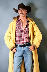 Rugged Cowboy (Cowboy Tommy) Tags: portrait hairy hot sexy fashion jean cigarette smoke blueeyes handsome wranglers moustache duster western stache tight plaid levis cowboyhat blazer hung bulge packingheat