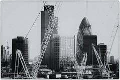 Buildings and cranes. (steff808) Tags: city inglaterra england blackandwhite bw london blancoynegro nikon noiretblanc londres angleterre biancoenero d90 nikond90 nikon18105