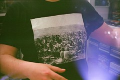 Shop Assistant (Sweet/Adeline) Tags: boy black guy lomo lomography hands hand fat picture tshirt analogue woodstock