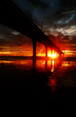 The Dawn Tempest (Steve Taylor (Photography)) Tags: ocean red sea newzealand christchurch sun beach clouds sunrise dawn pier pacific canterbury nz southisland sunup daybreak newbrighton theworldwelivein ministryofawesome