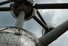 Caught In A Web - Atomium, Brussels (Janicskovsky) Tags: brussels sky panorama holiday building slr metal architecture clouds contrast french nikon iron belgium steel tubes bruxelles overcast panoramic architect exposition sphere cube belgian dslr magnified flemish spheres atomium atom worldsfair francais flanders magnification panoramicview heizel heysel d80 expo1958 nikond80 andrwaterkeyn ironcrystal boulevardducentenaire