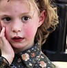 A Jewish girl, even/especially with rose cheeks, should learn to worry, from an early age (ybiberman) Tags: portrait girl israel eyes jerusalem chicks worry ultraorthodox meashearim