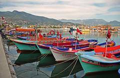 Alanya Boats (chrisshots) Tags: blue sea beautiful port reflections turkey boats nikon riviera day cloudy alanya chrisshots colorphotoaward d3000 kizilkule ringexcellence dblringexcellence