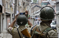 Getting it on camera.. (Rayan Naqash) Tags: india police kashmir
