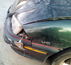 20150319 - Carolyn's car accident - smashed up Grand Am - driver's side front - (by Carolyn) - 20150319_080258 (Rev. Xanatos Satanicos Bombasticos (ClintJCL)) Tags: light car maryland fender vehicle hanging hood headlight smashed 1994 silverspring caraccident totaled carhood 2015 pontiacgrandam camerapersoncarolyn pontiacgrandamcar pontiacgrandam1994 pontiacgrandam1994car 201503 20150319 caraccident20150319