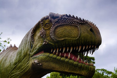 Big Grin (Tony Shertila) Tags: england weather gardens clouds model europe day cheshire dinosaur cloudy britain outdoor exhibition chester growth jungle jurassic dinosaurs extinct upton chesterzoo dinosauria botinicalgardens tiassic 20160601105706