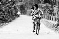 Brothers (Adrien Marc) Tags: boy bw bike child brothers depthoffield vietnam