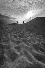 sands between the toes (Syauqi Qahar) Tags: two sky people bw cloud black texture vertical sand nikon foreground d7000