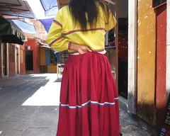 Phone Conversation (Maria Sciandra) Tags: red woman yellow mexico shadows streetphotography mercado sanmigueldeallende streetcandid sonyrx100 mariasciandraphotography mexaesthetic mariasciandracom