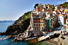 Cinque Terre (Artur Staszewski) Tags: old vacation italy architecture port canon buildings boats coast fishing italian colorful europe riviera european scenic sigma spot tourist terre visitors popular cinque attraction riomaggiore visited 550d 1770mm t2i