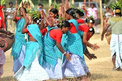Folk Dancers (pallab seth) Tags: woman india man festival religious dance nikon folk religion culture dancer tribal hindu bengal cultural shantiniketan westbengal 2011 adivasi tusu groupdance santiniketan bolpur makarasankranti poushmela parab d3100  grambanglarchobi