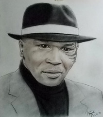 Boxing legend:  World Champion Boxer and actor Mike Tyson (fitzjim) Tags: show portrait man male sports closeup tattoo movie championship belt artist fighter married lasvegas african pastel pigeon pigeons rollerderby drawings legendary tattoos ring american knockout mao wife boxer bite reality africanamerican movies actor halloffame caesarspalace punch trunks boxing workout everlast edhelms disqualified trainer wwe hof cheguevara bombers autographed chairmanmao fieldofdreams worldchampion miketyson evanderholyfield heathergraham undisputed stetsonhat arthurashe jeffreytambor zachgalifianakis autographappearance jimfitzpatrick justinbartha inducted daysofgrace 1984summerolympics bradlycooper malikabdulaziz sfbaybombers cusdamato mancavememorabilia bitingoffpartofear lakihaspicer wwehalloffameclassof2012 youngestfighter