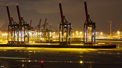 #105 Port of Hamburg Nightlife (flickranet) Tags: longexposure schnee winter light urban reflection water windmill skyline night canon reflections river germany deutschland 50mm lights iso100 licht colorful wasser industrial nightshot nacht harbour crane dusk tripod hamburg cranes ufer hafen fluss kran industrie ef50mmf18ii waterside elbe hamburgerhafen lightbeams lichter nachtaufnahme twillight elbufer abendstimmung reflektionen leuchten urbannightshot lichtstrahlen yabbadabbadoo riverelbe hafenhamburg canonef50mmf18ii eisschollen dunklerhimmel positionlights 60d portofhamburg canon60d canonef50mm118ii krane positionslichter dammerung hamburgpanorama canoneos60d kohlbrandbrucke bankoftheelbe hamburgattraction dammern flickranet kohlbrand