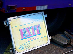 Exit Sign Leaning Against A Trailer. (dccradio) Tags: carnival wisconsin mall parkinglot wi amusements marshfield dairyfest shoppesatwoodridge earlsrides