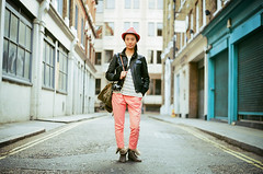 London Street Fashion 2012 (Alvaro Arregui) Tags: street uk urban london hat asian pentax kodak soho streetphotography pinkhat pentaxmx pentaxp30t kodakportra kodakportra160 zeisspancolar londonstreetfashion sohofashion zeisspancolarzebra50mmf18