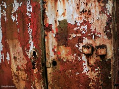 Peeling Paint & Oxidation (sixty8panther) Tags: door red usa white macro green broken metal closeup scarlet handle iron peeling paint doors lock teal steel newengland rusty storage container rusted oxidation layers rusting rough flakes flaking crusty cracked coarse paintchips dracut rustcolored massachusett peellingpaint dracutma