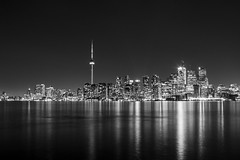 Toronto, Black and White (tamjty) Tags: city longexposure nightphotography sky urban blackandwhite bw toronto ontario canada monochrome skyline night contrast canon buildings reflections photography eos lights downtown cityscape cntower skyscrapers harbour citylights 7d f28 2470mm