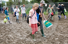 People Walking In Mud  At Glastonbury Festival UK (Roger Cracknell Photography) Tags: travel camping girls vacation people colour boys rain festive fun student women couple holidays mud traditional crowd culture teenagers bighair celebration recreation wellies fancydress crowds cultural attraction festivalgoers traveldestination