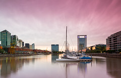 Sun Setting on Puerto Madero (Jim Boud) Tags: travel pink sunset seascape reflection southamerica argentina skyline sailboat port marina canon buildings boats harbor cityscape skyscrapers dusk pastels puertomadero 2012 60d canon60d jimboud bueneosaires canoneos60d jamesboud sttandardbank