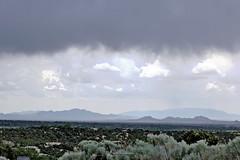 Ortiz & Sandia Mountains (Sacker Foto) Tags: mountains newmexico santafe rain contrast landscape day top vista peaks ortiz hdri canonef50mmf18ii niftyfifty picturenauthdr cs5photoshop mountainssandia offgonzalesroad fromthehillsof offhydeparkroad