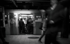 Underground Observations II (Dj Poe) Tags: new york city nyc light people bw white ny black station train underground subway dj candid voigtlander authority trains transit mta epson seiko poe f4 available 2012 rd1 21mm colorskopar