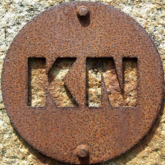 KN (chrisinplymouth) Tags: squircle circle round letters metal iron rust rusting corrosion corroded cw69x twoletter alphabet doublet kn cutout sign steel mountbatten plymouth devon unitedkingdom england uk plate disc rusty nauticaltelegraphcode sculpture art squaredcircle oxidation