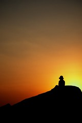 (nathan.c.potter) Tags: travel sunset red sky woman india silhouette yellow colorful hampi