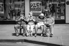Sitting and Watching (gwpics) Tags: uk greatbritain england people blackandwhite monochrome bench mono europe sitting britishisles unitedkingdom britain seat streetphotography eu salisbury wiltshire editorialuseonly