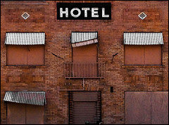 Hotel Arizona (Junkstock) Tags: old windows arizona signs building brick abandoned window phoenix sign wall architecture buildings typography photography hotel photo graphics junk graphic photos decay bricks photographs photograph storefront signage type americana weathered aged storefronts artifact artifacts patina relic iphone oldandbeautiful agedwindow
