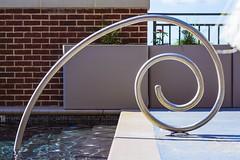 Spiral (Chris B Richmond) Tags: park sun brick water pool metal canon spiral concrete outside handle golden al outdoor alabama rail sunny capitol tuscaloosa railing dslr curve poolside ratio