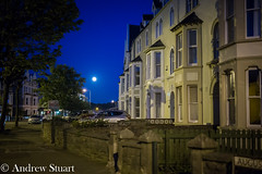 Large evening moon shines over Llandudno's Augusta Street (andrew.stuart1) Tags: street moon wales evening town andrew stuart fullmoon augusta lunar llandudno andrewstuart context