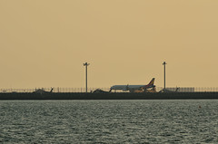 ASIANA and JASDF (Kazzy1356) Tags: sunset sea airplane nagoya ngo chubu centrair