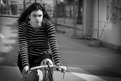 Concentrated... (Periades) Tags: blackandwhite bw girl bike bicycle noiretblanc streetphotography nb fille vlo streethuman
