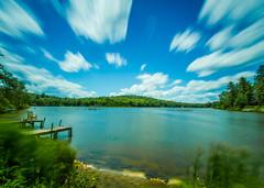 Mountain Lake Under A Moving Sky (Catskills Photography) Tags: longexposure sky lake clouds landscape sullivancounty canon1022mmlens leebigstopper