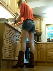 Boots n shorts (jjay69) Tags: woman cooking kitchen leather work boots des indoors denim shorts cupboards cowboyboots lowangle denimshorts