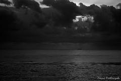 "IMG_1652_20120317 ""Ship 'n Rays"" (Kesara Rathnayake (kesara.lk)) Tags: eve sunset sea sky blackandwhite bw sun clouds evening blackwhite ray ship horizon lanka rays srilanka colombo marinedrive"