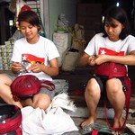 "Girls in NLD Gear Making Alms Bowls <a style=""margin-left:10px; font-size:0.8em;"" href=""http://www.flickr.com/photos/14315427@N00/7070338255/"" target=""_blank"">@flickr</a>"
