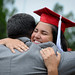 Parents and graduates share hugs after the ceremonies.