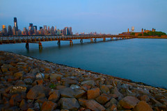 Hazy Lazy Evening (SunnyDazzled) Tags: city longexposure bridge newyork tourism skyline skyscraper landscape fun island four one 1 evening bay newjersey construction view ellis stones manhattan worldtradecenter 4 scenic shore hudson riverbank memorialday libertystatepark freedomtower