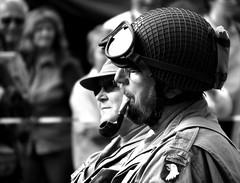 Pipe Smoking Soldier (CoolMcFlash) Tags: american soldier us army uniform man person bw black white military parade vienna austria arsenal aufkettenräder heeresgeschichtlichesmuseum hgm oldtimertreffen amerikanischer soldat mann schwarz weis sw monochrome militär wien österreich smoker rauchen pfeife pipe brillen googles 2012 airborne portrait face gesicht canon eos 60d tamron b008 18270 aufkettenundräder aufrädernundketten aufrädernketten smoking pipesmoker blackandwhite photography fotografie bnw