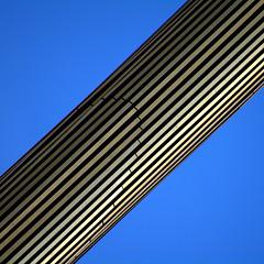 all joined up (fourcotts) Tags: madrid plaza blue sky abstract monument square de gold spain pentax caja diagonal espana obelisk castilla k7 pentaxart fourcotts cajamadridobelisk