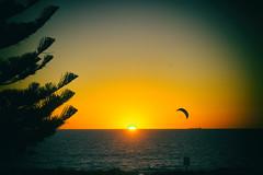 The lonely kite surfer (biscotti.007) Tags: kitesurfing silhouette beach australia water fujifilm fujinon fujilovers kodachrome vintage film color summer sun paradise surf golden orange sky