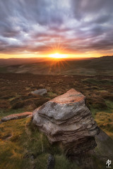The Grey Stone and the Setting Sun... (fearghal breathnach) Tags: higgertor peakdistrict sunset landscape england portrait rock boulder foreground rays rayoflight sunburst sun light shootintothelight