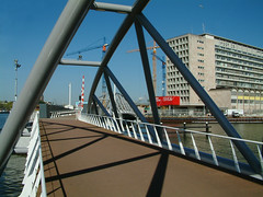 View over the bridge for pedestrians and cyclists, connecting the Nemo museum with the Oosterdok area, at the right the Head Post Office built in the 1960's but now demolished; photo of  2005, Amsterdam by Fons Heijnsbroek geotagged and in public domain (Amsterdam city photos, geotagged) Tags: 2005 city bridge urban public amsterdam museum modern geotagged photography cyclists office nemo post pedestrians domain oosterdok