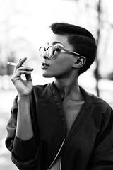 .The Wastelander. (RichardTerborg) Tags: red blackandwhite bw netherlands dutch sunglasses fashion glasses bokeh style smoking depthoffield cig 5d canon5d blackgirl styling blackmodel