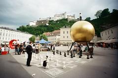 Salzburg (iampaulrus) Tags: paulfargher paulfargherphotography 35mm film lomo lomography colour color lcwide munich salzburg castle austria townsquare chess wideanglelens