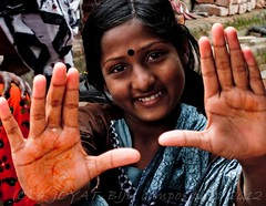 Happiness captured in frame . . . (joyat biju) Tags: portrait color smile look person hand happiness henna mehendi rugged harsh