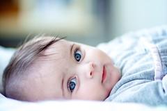 59/365(+1) (Luca Rossini) Tags: blue portrait baby project bed eyes minolta f14 sony 85mm 365 laying flickrexportdemo nex7 3651daysofnex7 366nexblogspotcom
